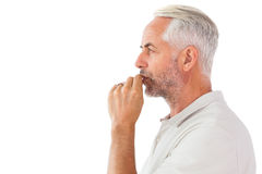 Man staying silent with finger on lips Stock Image