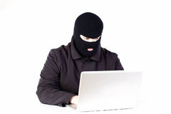 Man stealing data from a laptop Royalty Free Stock Images