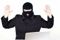 Man stealing data from a laptop Stock Image