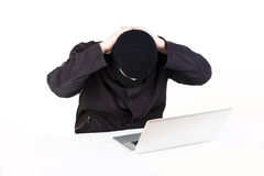 Man stealing data from a laptop Stock Photos