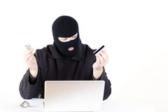 Man stealing data from a laptop Royalty Free Stock Photos