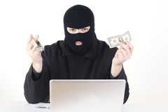Man stealing data from a laptop Royalty Free Stock Image