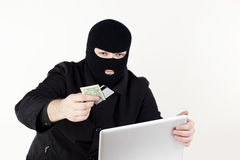 Man stealing data from a laptop Stock Photo