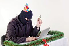 Man stealing data from a laptop Royalty Free Stock Photography