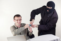 Man stealing data from a laptop. Thief on the notebook. Fraud. Shopping onlie Stock Images