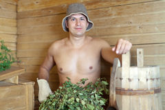 Man is steamed in the sauna Royalty Free Stock Image