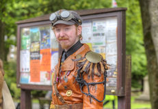 Man in Steampunk outfit. Friendly young man in leather jacket and steampunk regalia at Saddleworth Band Contest, 17th of June, 2011 Stock Photos