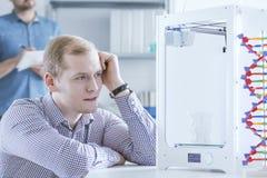 Man stearing at 3D printer Stock Images