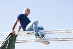 Man on steel structure no protection for safety Royalty Free Stock Image