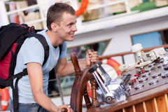 Man is steering the helm. Man with helm on yacht Stock Images