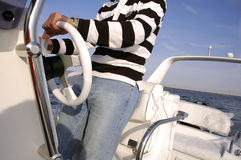 Man steering a speedboat Royalty Free Stock Images