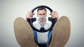 Man with a steering wheel, front view. Driver car concept Stock Images
