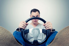 Man with a steering wheel, front view. Driver car concept.  Royalty Free Stock Images