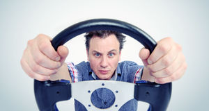 Man with a steering wheel, front view. Driver car concept Royalty Free Stock Photography
