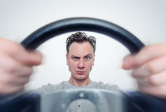 Man with a steering wheel, front view. Driver car concept.  Stock Image