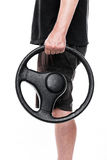 Man with steering wheel. Is standing in front of white, sideview royalty free stock images