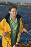 Man At Steering Wheel On Yacht Stock Images