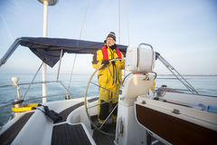 Man Steering Wheel Of Yacht In Sea Royalty Free Stock Image