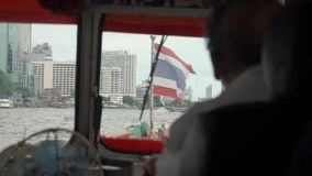 The man steers the boat. Going on water along the city stock video