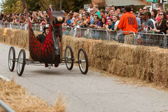 Man Steers Dragon Vehicle Down Street In Soap Box Derby Royalty Free Stock Photo
