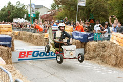 Man Steers Furniture Vehicle Over Ramp In Soap Box Derby Stock Photos