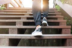 A man step up to success, sport man is climbing on wooden step stock photography