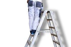 Man on stepladders Stock Image