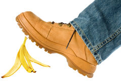 Man stepping on banana peel Stock Images