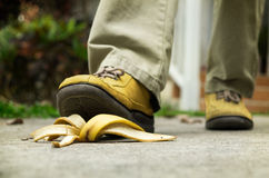 Man stepping on banana peel Royalty Free Stock Images