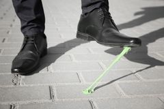 Man stepping in chewing gum on sidewalk. Concept of stickiness Stock Image
