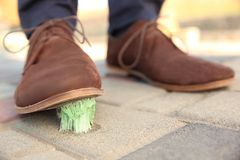 Man stepping in chewing gum on sidewalk stock photos