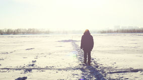 Man steps in the snow in winter. Man steps in the snow Royalty Free Stock Photos
