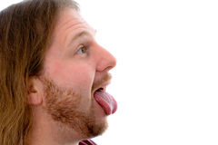 man stick out the tongue Stock Photography