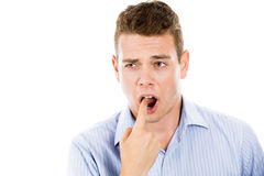 Man sticking finger in mouth about to throw up or show something sucks Royalty Free Stock Photo