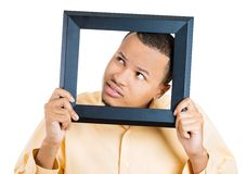 Man sticking head in picture frame Royalty Free Stock Image