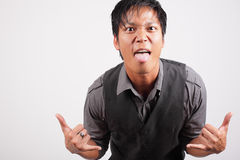 Man sticking his tongue out. Image of a man with an attitude sticking out his tongue Royalty Free Stock Photos