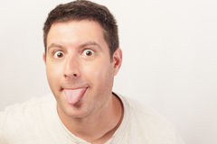 Man sticking out his tongue Stock Photography