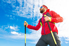 Man with sticks between nordic walking with sky background Stock Photography