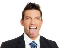 Man sticks out tongue Royalty Free Stock Image