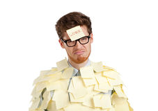 Man with a sticky note on his face Stock Images