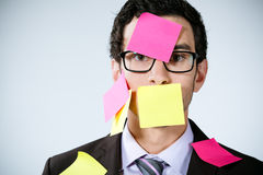 Man with sticky notes on face Royalty Free Stock Photography