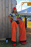 Man on stilts takes a break Stock Photo