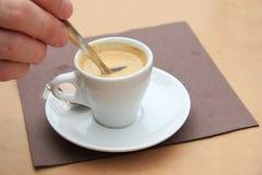 Man stiring an espresso Stock Image