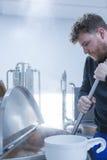 Man stirring craft beer Stock Photography