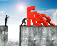 Man stopping fear word domino falling with another shouting. Man stopping domino of red fear word falling with another man holding speaker shouting on top of Royalty Free Stock Photo