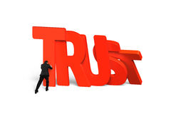 Man stopping red trust word dominoes falling Royalty Free Stock Photo