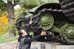 Man stopping tank Royalty Free Stock Image