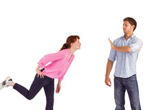 Man stopping woman from kissing. Man stopping women from kissing on white background Stock Photography
