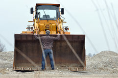 Man stops big wheel loader Stock Images
