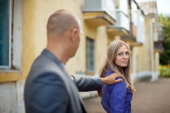 The man stops woman. The men stops women on city street Royalty Free Stock Images